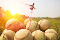 Baseball players practice wave a bat in a field Royalty Free Stock Photography