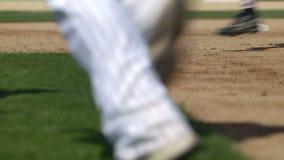 Baseball players run across field in slow motion