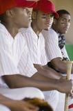 Baseball Players Sitting Together Stock Photo