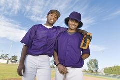 Baseball Players Standing Against Sky Royalty Free Stock Photos