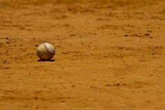 Baseball on playing field Royalty Free Stock Photography
