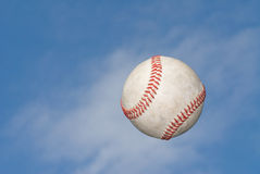 Baseball pop up. A baseball flys through the air after being hit for the fence Royalty Free Stock Image