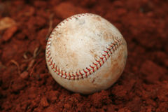 Baseball in Red Dirt Stock Photo