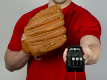 Baseball and the Remote. Stock Photo