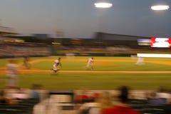 Baseball running blur. Baseball runner going for first base Stock Photos