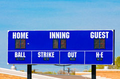 Baseball scoreboard with blue sky Stock Images