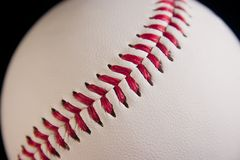 Baseball seam. Close-up of a new baseball and its seam stock photography