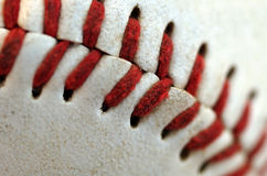 Baseball Seams Macro. Close up of the blood red seams of a regulation baseball Stock Image