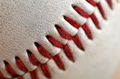 Baseball Seams Macro. Close up of the blood red seams of a regulation baseball Royalty Free Stock Photos