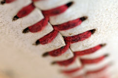 Baseball Seams Macro. Close up of the blood red seams of a regulation baseball Royalty Free Stock Photo