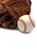 Baseball season. Close up of a baseball glove and ball isolated on white Royalty Free Stock Photography