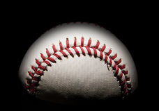 Baseball in the shadows. Single baseball in the shadows with room with black copy space above Stock Photos