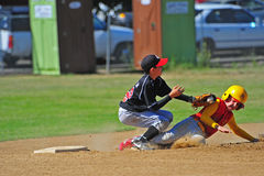 Baseball sliding into the tag. stock photos