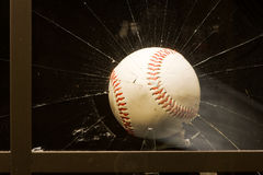 Baseball smashing window Royalty Free Stock Images