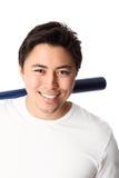 Baseball-Spieler im weißen T-Shirt mit Schläger Stockbild