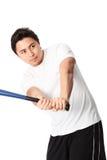 Baseball-Spieler im weißen T-Shirt mit Schläger Stockfotos