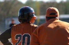 Baseball-Spieler und Unterseitentrainer Lizenzfreies Stockbild
