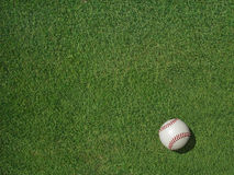 Baseball on Sports Turf Grass. Baseball on green sports turf grass Royalty Free Stock Images