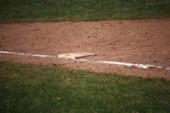 Baseball - 1st grund Arkivbild