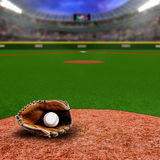 Baseball Stadium With Glove and Ball With Copy Space. Fictitious baseball stadium full of fans in the stands with baseball glove and ball on infield dirt clay Stock Image