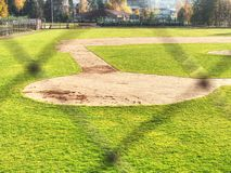 Baseball stadium. Green grass on baseball field stock images
