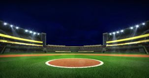 Baseball stadium infield circle spot view illuminated at night stock footage