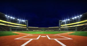 Baseball stadium infield diamond view illuminated at night