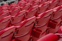 Baseball stadium seats. Grand stands of red stadium seats Royalty Free Stock Photos