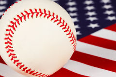 Baseball, stars and stripes,. Macro view of baseball set on an american flag, baseball, stars and stripes our national pastime stock photography