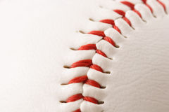 Baseball Stitches Macro. Close-up of the stitches on a baseball (narrow focus Stock Photo