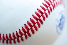 Baseball stitching. Closeup of the red stitching on a baseball Stock Photography