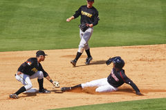 Baseball - stolen base or tagged out?!
