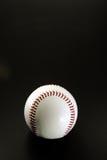 Baseball sul nero, verticale Fotografie Stock Libere da Diritti