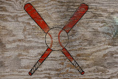 Baseball Symbol. Rustic vintage baseball symbol on weathered wood surface Royalty Free Stock Photography