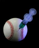 Baseball and syringe. Symbolize one of the most controversial issues in baseball and other sports today: the illegal use of performance enhancing drugs stock photos