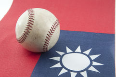 Baseball and Taiwan Flag. In Taiwan ,a lot of people like to play Baseball so much so baseball which used in that place will come to sport of country royalty free stock photography