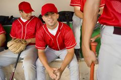 Baseball team-mates in dugout. Baseball team-mates sitting in dugout stock photos