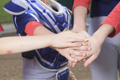 Baseball team puting hand together. A baseball team puting hand together Royalty Free Stock Images