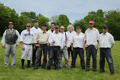 Baseball team in 19th century vintage uniform during old style base ball play following the rules and customs from 1864 Royalty Free Stock Images