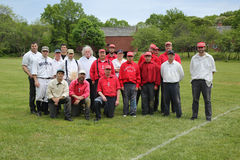 Baseball team in 19th century vintage uniform during old style base ball play following the rules and customs from 1864. OLD BETHPAGE, NEW YORK - MAY 22, 2016 Royalty Free Stock Photography