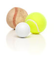 Baseball, Tennis and Golf Ball on White. Baseball, Tennis and Golf Ball Isolated on a White Relfective Background Stock Images