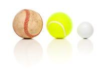 Baseball, Tennis and Golf Ball on White. Baseball, Tennis and Golf Ball Isolated on a White Relfective Background Stock Photos