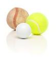 Baseball, Tennis und Golfball auf Weiß Stockbilder
