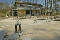 Baseball trophy and debris in front of house Stock Photography