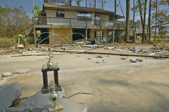 Baseball trophy and debris in front of house heavily hit by Hurricane Ivan in Pensacola Florida Stock Image