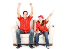 Baseball: Two Fans on Couch and Cheering. Springtime American Baseball series, with male and female models, as fans, and umpire.  Isolated on white for easy Stock Photo