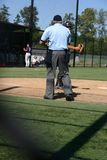 Baseball Umpire. On field with player Royalty Free Stock Photography