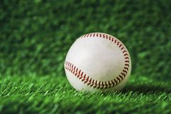 Baseball used put on green grass background. Royalty Free Stock Photo