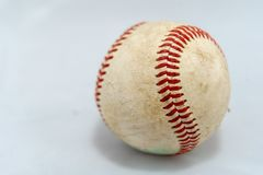 Used baseball on white background. Worn and used baseball on a white background and shadowed royalty free stock images