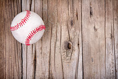 Baseball on wooden background. Baseball on rustic wooden background Royalty Free Stock Photos